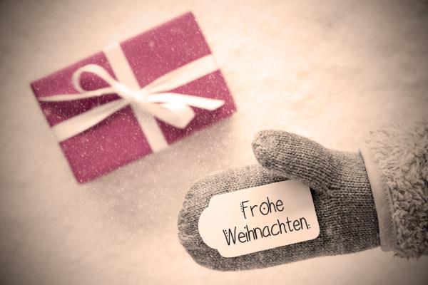 guante gris regalo rosa etiqueta copos