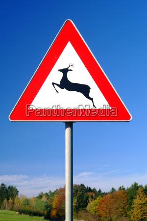 road sign deer crossing