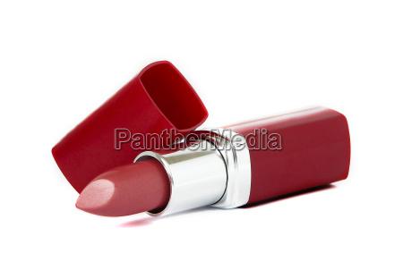 lapiz labial rojo sobre fondo blanco