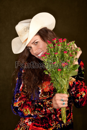 pretty woman with flowers on green
