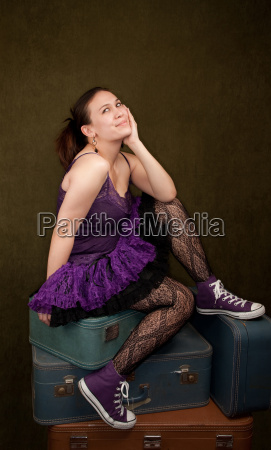 pretty girl in funky purple outfit