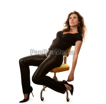 pretty woman in black seated on