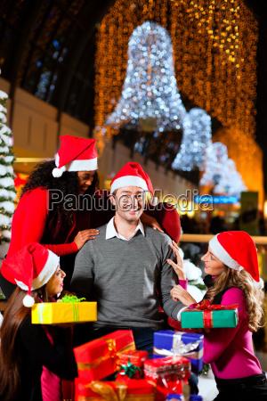 modern santa claus in shopping zent