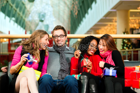 friends at christmas in shopping center