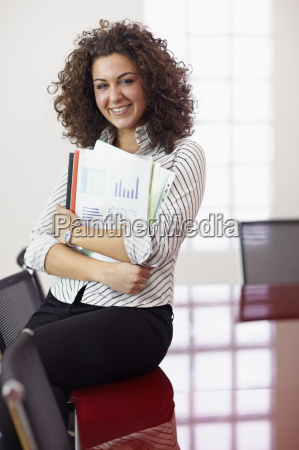 pretty secretary with charts smiling at