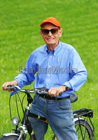 senior with bicycle