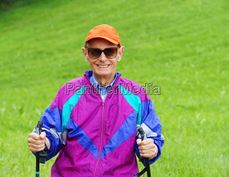 happy senior nordic walking