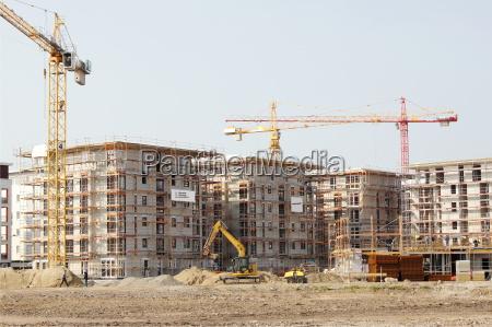 excavadora area de construccion guarida bienes