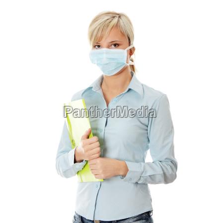 mujer del estudiante con la mascara