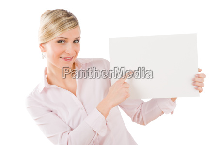 happy businesswoman pointing aside at empty