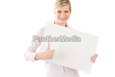 happy businesswoman behind empty banner thumbs