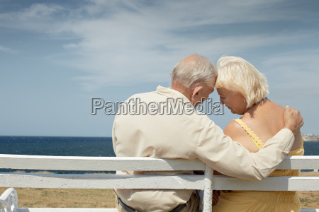 old man and woman on bench