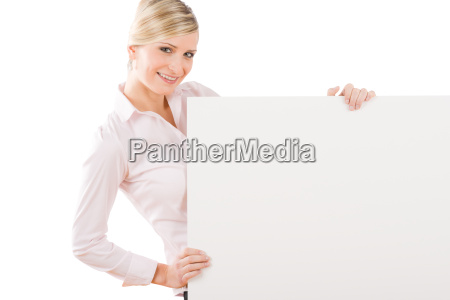 happy businesswoman behind empty banner landscape