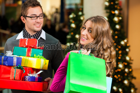 couple at christmas in department store