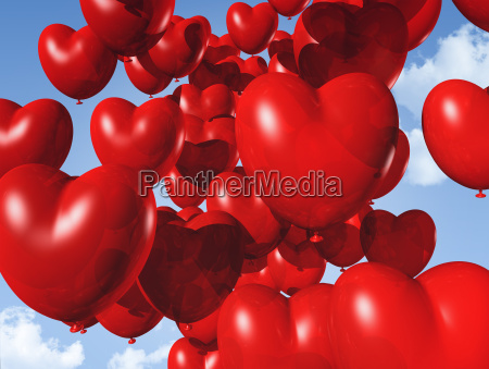 red heart shaped balloons floating in