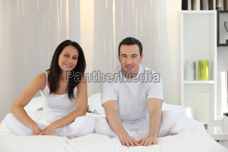 couple sitting in their bed