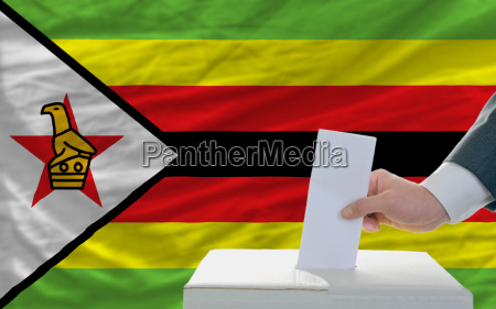 man voting on elections in zimbabwe