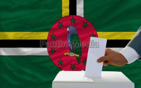 man voting on elections in dominica