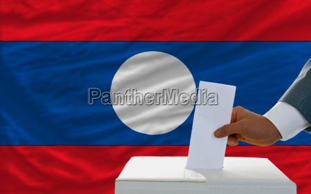 man voting on elections in laos
