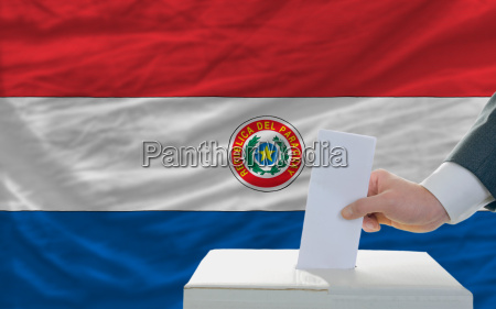man voting on elections in paraguay