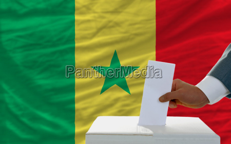 man voting on elections in senegal