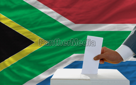man voting on elections in south