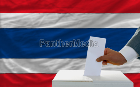 man voting on elections in thailand