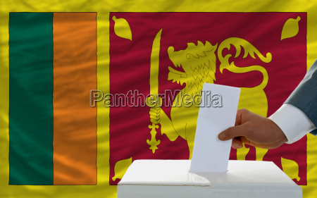 man voting on elections in srilanka