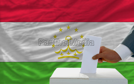 man voting on elections in tajikistan