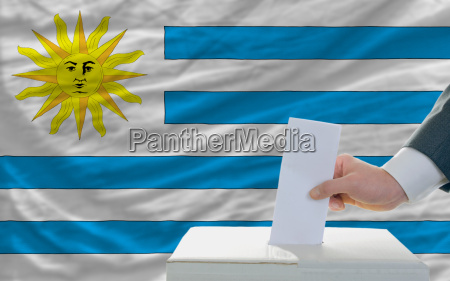 man voting on elections in uruguay
