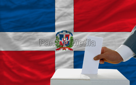 man voting on elections in dominican
