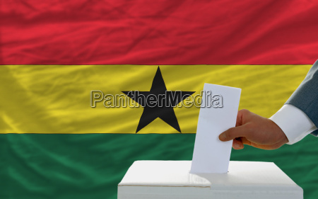 man voting on elections in ghana