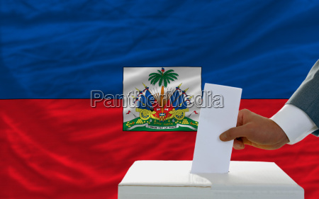 man voting on elections in haiti