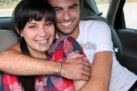 happy couple embracing in car