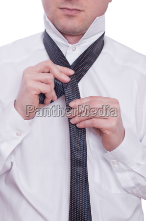 two hands and tie