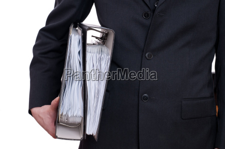 man in suit holding two folders