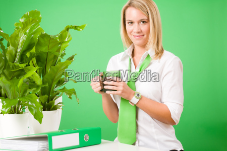 green business office woman smiling coffee