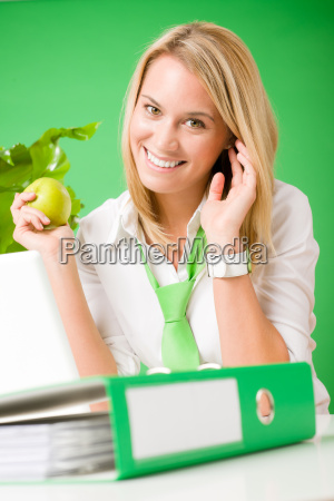 green office woman smiling hold apple
