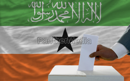 man voting on elections in front