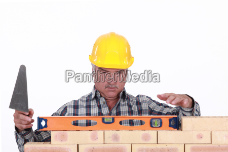 construir masculino persona uniforme pared adulto