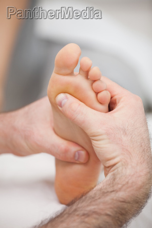 sole of foot being massaged