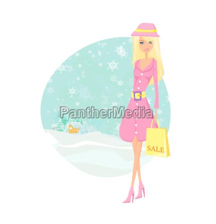 moda chica de invierno con bolsas