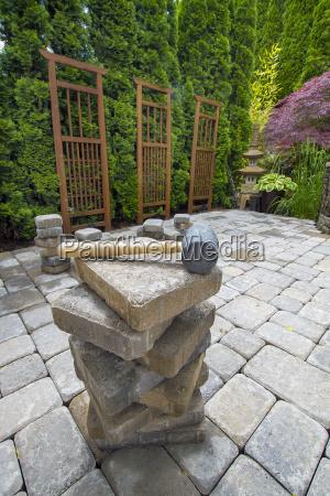stack of pavers on backyard garden