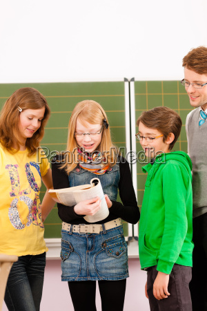 students with teacher in front of