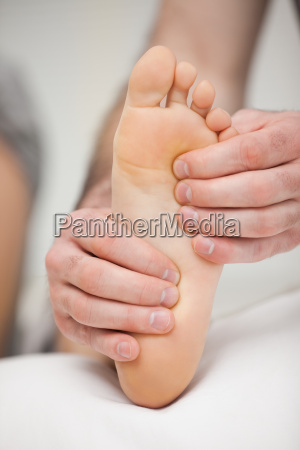 fingertips touching the sole of a