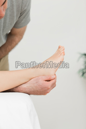 podiatrist examining the foot of his