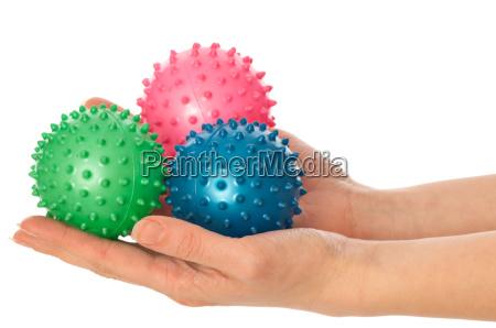 tres bolas de masaje coloreadas