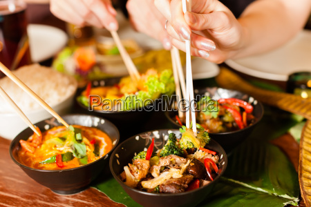 young people eating in a thai