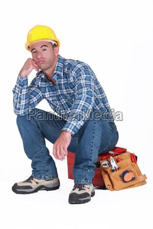 aburrido constructor se sento en la