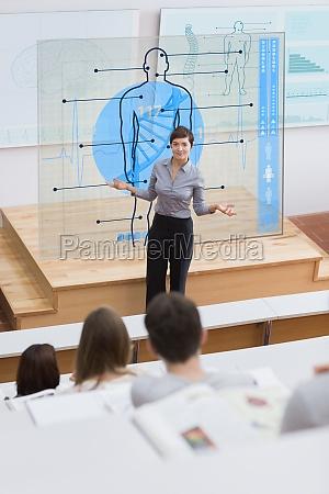 mujer estudio azul profesor escritorio educacion